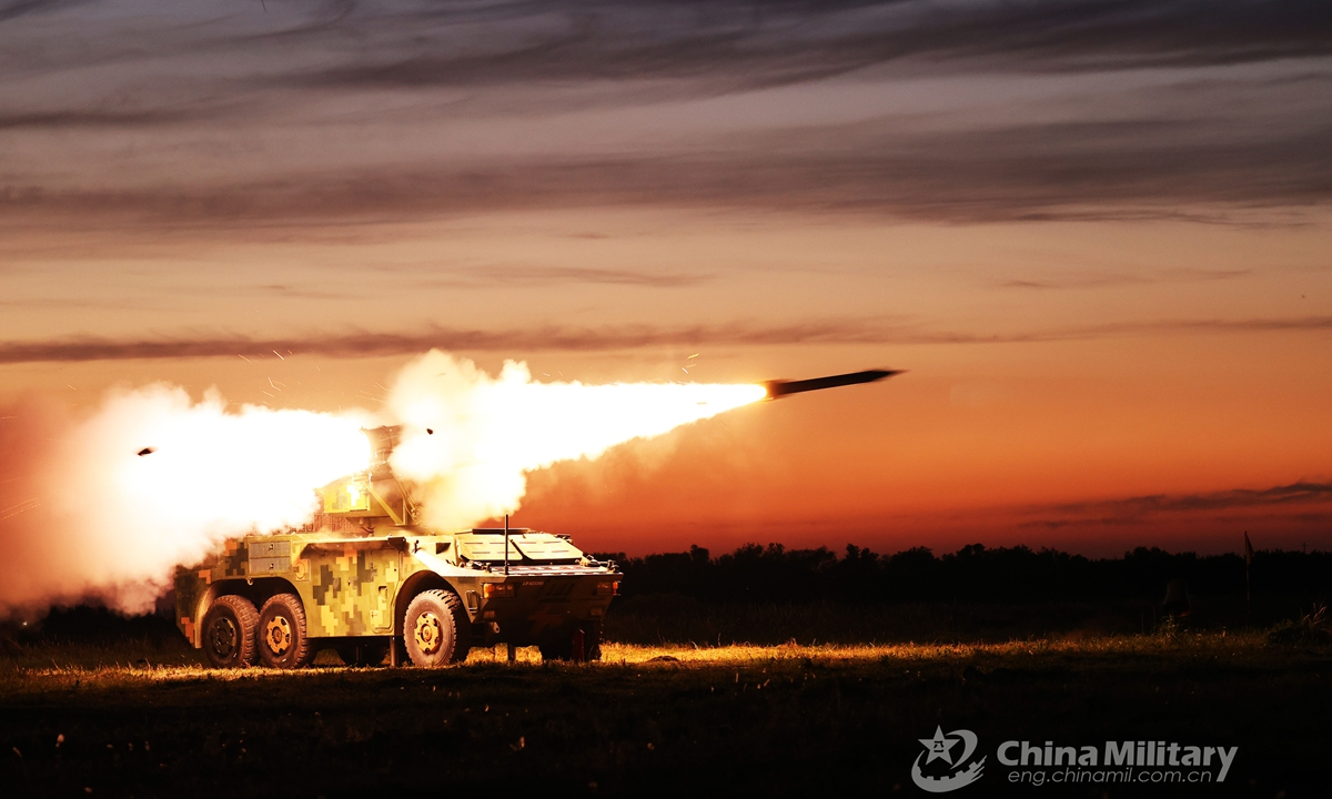 An armored vehicle assigned to the missile element assigned to a brigade under the PLA 80th Group Army fires the missile during a live-firing assessment on May 17, 2021.Photo:China Military
