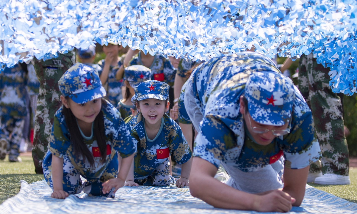 Children and parents participate in a military-themed sports game in Taizhou, Zhejiang on Saturday. Photo: IC