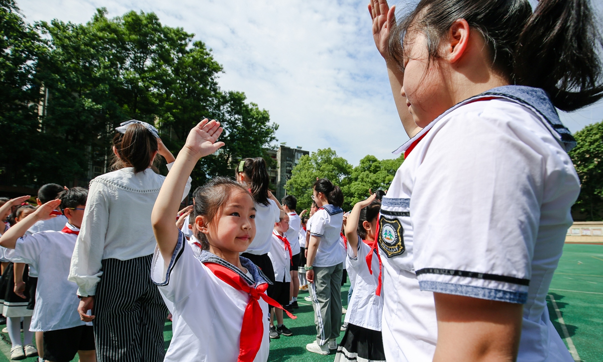 Young students join the Young Pioneers of China ahead of Children's Day on May 27 in Tongling, Central China's Anhui. Photo: IC