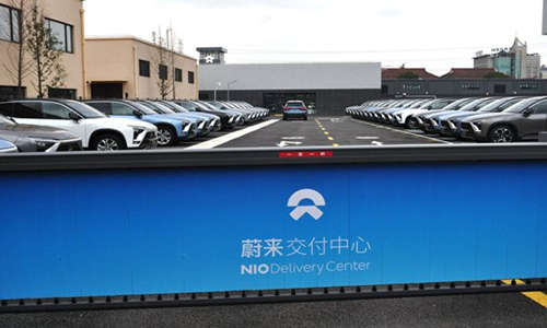 NIO electric cars are lined up at the NIO Delivery Center in Shanghai on Monday. The delivery center is the first of its kind in Shanghai, where potential customers can view NIO SUV models. There is also a test drive area. The Tencent-backed electric car start-up successfully completed its initial public offering in the US on September 12, and has been described as Chinese rival to Tesla. Photo: VCG