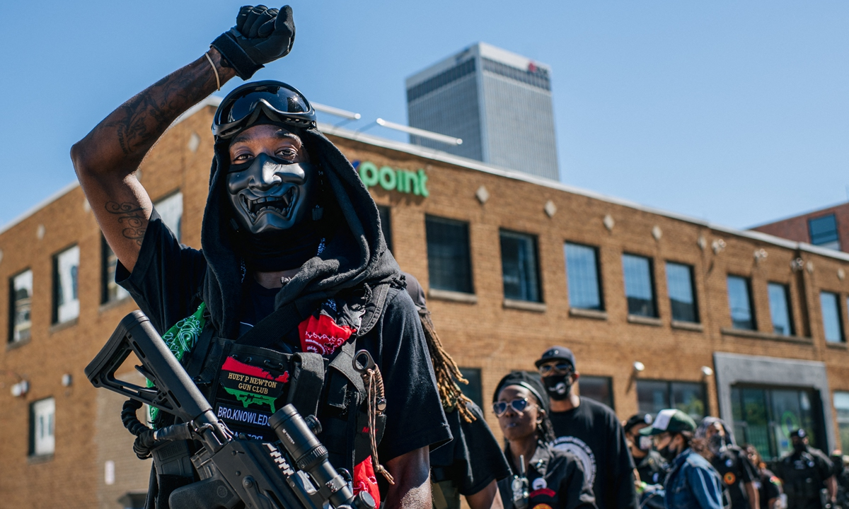 Members of the Black Panther Party and other armed demonstrators rally in the Greenwood district during commemorations of the 100th anniversary of the Tulsa Race Massacre on Saturday in Tulsa, Oklahoma, the US. Photo: AFP