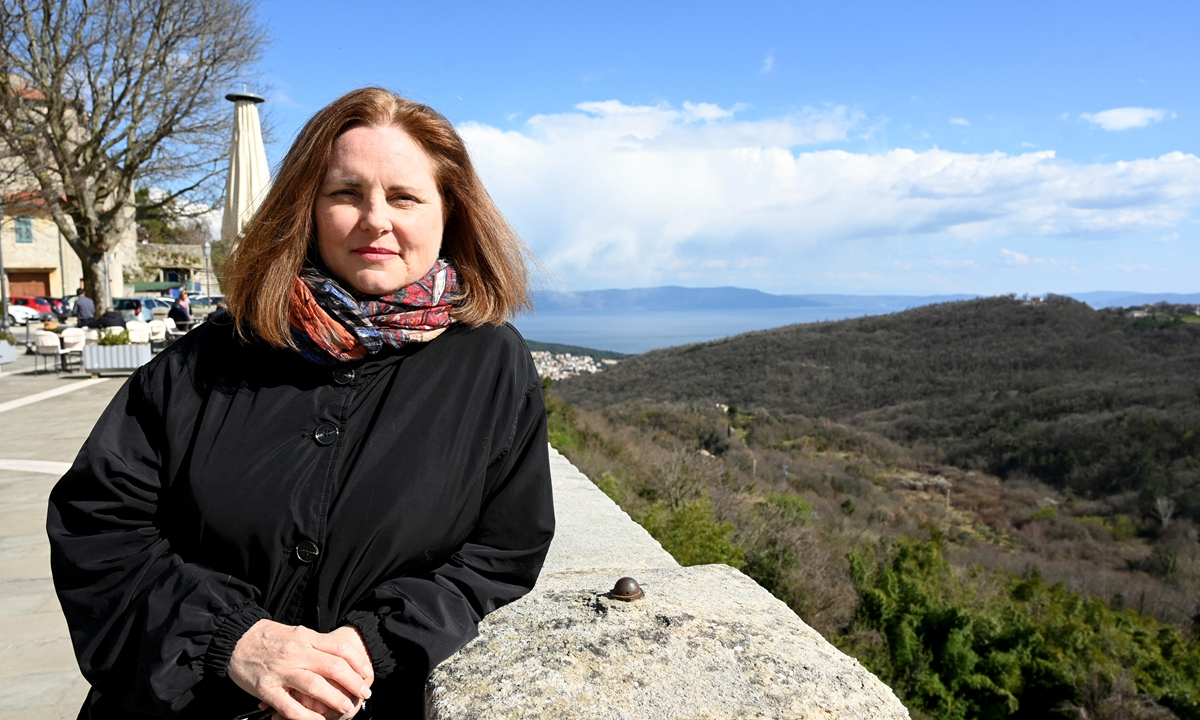 US marketing consultant Melissa Paul, who became Croatia's first official digital nomad in January, poses in the old part of Labin, a hilltop town overlooking the Adriatic known for its cobblestone streets, on March 18. Photo: AFP