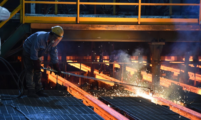 A worker is busy working at the production line of a special steel production enterprise in Haibowan District of Wuhai City, north China's Inner Mongolia Autonomous Region, April 22, 2020.(Photo: Xinhua)