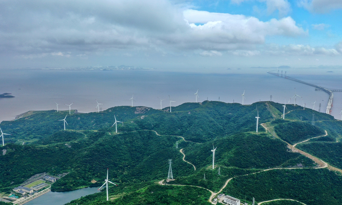 Wind turbines rotate as sea breezes flow through the Cengang Wind Farm in Zhoushan, East China's Zhejiang Province on Tuesday. The farm delivered 29.88 million kilowatt-hours of green power into the national grid from January to May this year. It's calculated that's enough to reduce carbon dioxide emissions by about 24,300 tons. Photo: cnsphoto