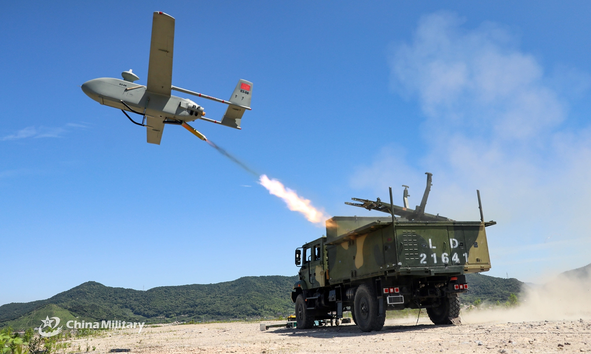 An unmanned aerial vehicle (UAV) is launched for a flight training exercise conducted by an artillery brigade under the PLA 71st Group Army on May 31, 2021. (eng.chinamil.com.cn/Photo by Wu Zhaobing)