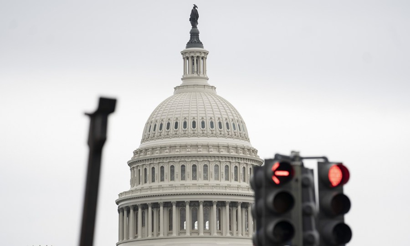 Photo taken on May 28, 2021 shows the US Capitol building behind traffic lights in Washington, DC, the United States.Photo: Xinhua