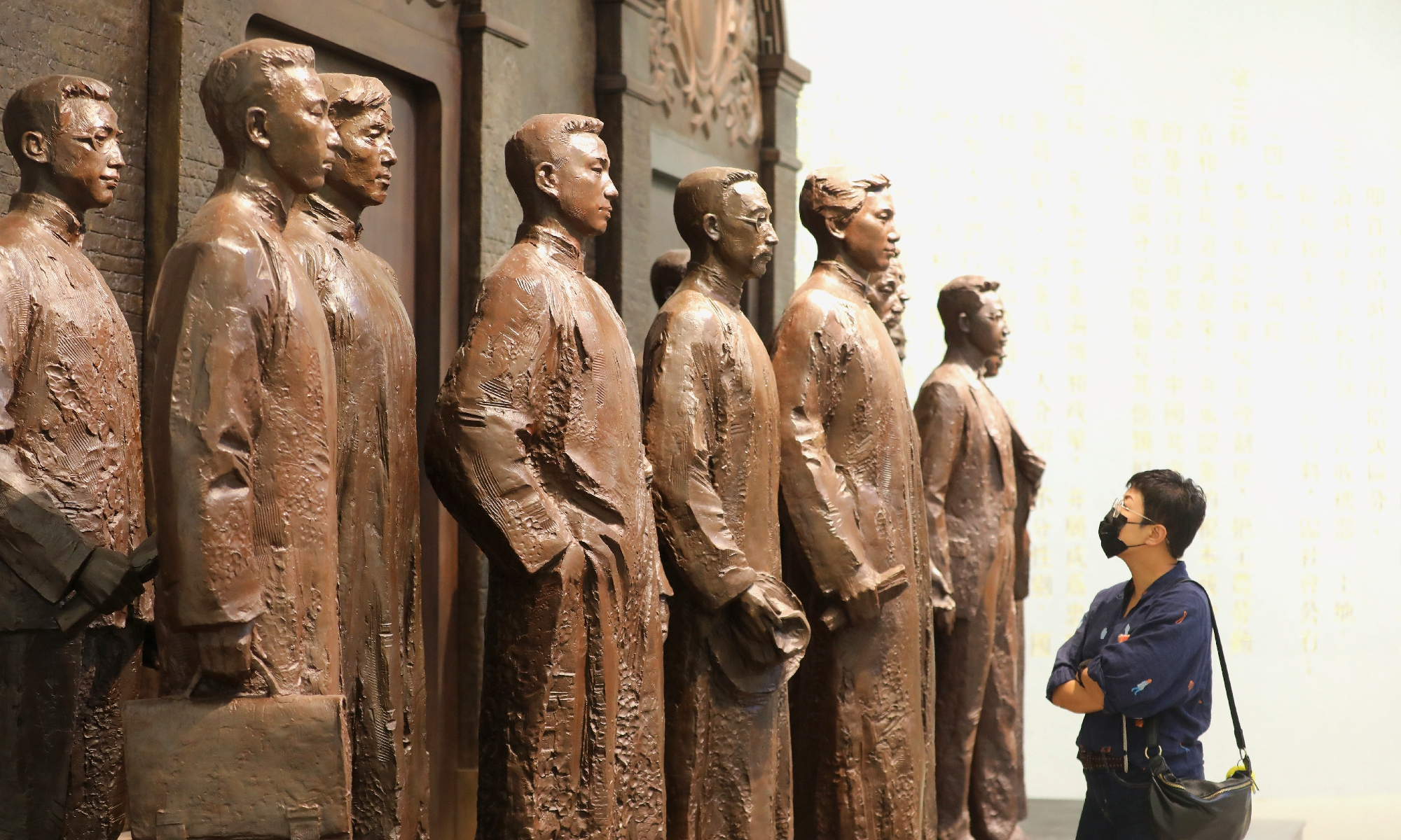 A visitor looks at statues of earlier generations of revolutionaries at the site of the First National Congress of the CPC in Shanghai on Thursday when restoration at the site finished and it is reopened to the public as a museum. Photo: Yang Hui/GT