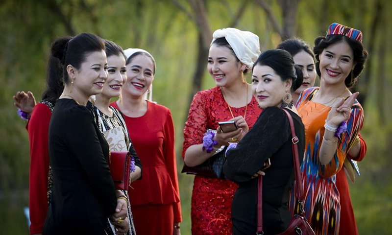 Residents participate in a wedding ceremony at a scenic spot by Ili River in Yining of northwest China's Xinjiang Uygur Autonomous Region, May 5, 2017.Photo:Xinhua