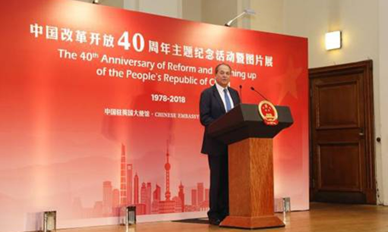 """Stephen Perry addresses the photo exhibition titled """"A Glorious Journey"""" held by the Chinese Embassy in the UK, December 11, 2018"""