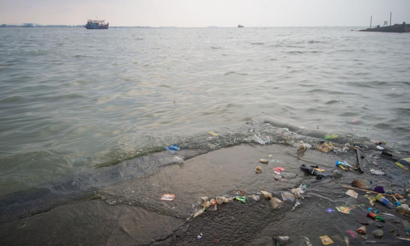 Photo taken on June 8, 2021 shows waste on the seaside at Muara Angke fishing village of North Jakarta, Indonesia. June 8 marks World Oceans Day. This year's theme is The Ocean: Life and Livelihoods. (Photo by Veri Sanovri/Xinhua)