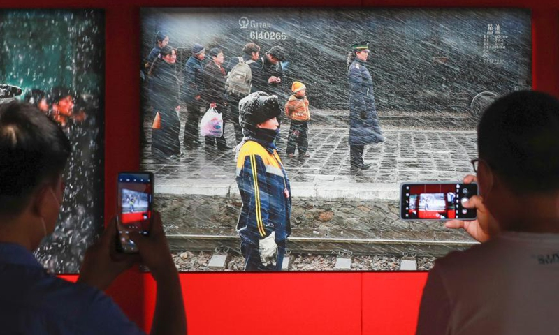 People take photos at the National Railway Photography Exhibition held in China Railway Museum, Beijing, June 8, 2021.  Photo: China News Service