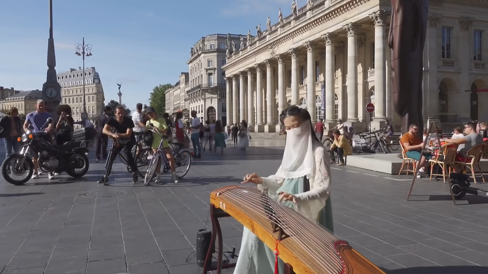 Screenshot of Peng Jingxuan's video on YouTube, in which she performs the Chinese Song Yi Jian Mei on the guzheng, a traditional music instrument, on the streets in France.