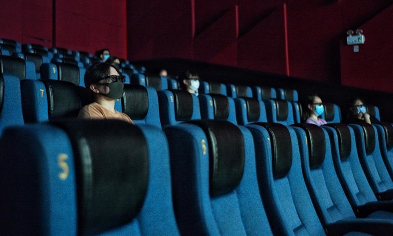 People watch a movie at the Capital Cinema (Xidan branch) in Beijing, capital of China, July 24, 2020. Part of cinemas in Beijing resumed operations on Friday with effective epidemic prevention measures in place. Photo: Xinhua