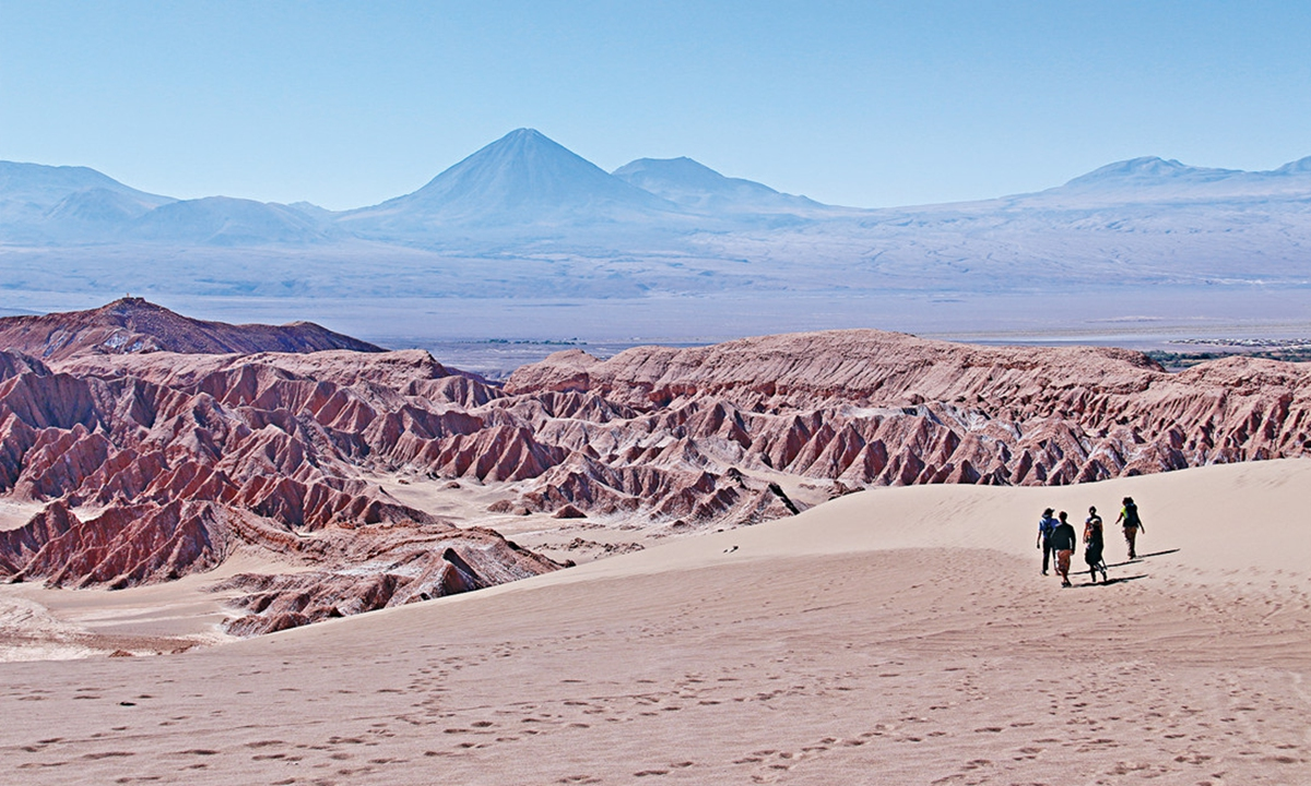Sightseers enter the Atacama Desert in northern Chile. The spectacular scenery of the desert is known for resembling the surface of the moon.
