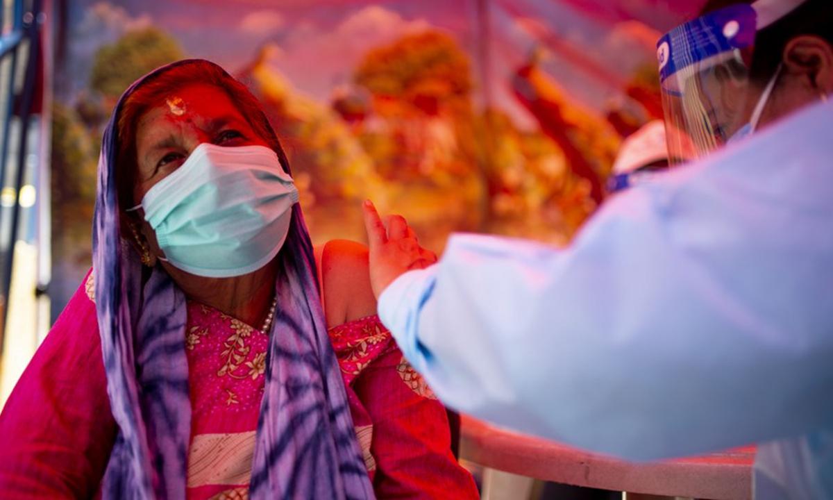 A woman receives a dose of COVID-19 vaccine in Kathmandu, Nepal, June 8, 2021. (Xinhua/Sulav Shrestha)