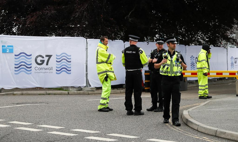 Police officers and security personnel work outside the G7 media center in Falmouth, Cornwall, Britain, on June 11, 2021. The first in-person G7 summit kicked off on Friday in Britain's southwestern resort of Carbis Bay, Cornwall, in almost two years. Photo:Xinhua