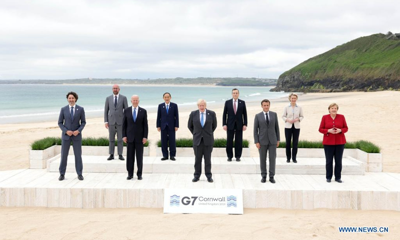 (From L to R, Front) Canadian Prime Minister Justin Trudeau, U.S. President Joe Biden, British Prime Minister Boris Johnson, French President Emmanuel Macron, German Chancellor Angela Merkel, (From L to R, Rear) European Council President Charles Michel, Japanese Prime Minister Yoshihide Suga, Italian Prime Minister Mario Draghi, and European Commission President Ursula von der Leyen, stand for a family photo during the Group of Seven (G7) Summit in Carbis Bay, Cornwall, Britain, on June 11, 2021. Photo:Xinhua