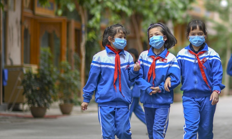 Children walk in a street after school at a scenic spot in the ancient city of Kashgar, northwest China's Xinjiang Uygur Autonomous Region, May 16, 2020.Photo: Xinhua