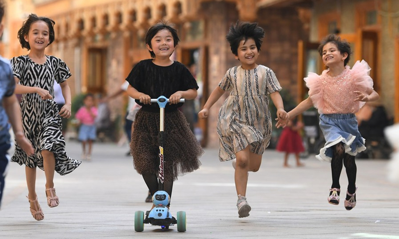 Children have fun in Dove Lane in the old town Tuancheng of Hotan City, northwest China's Xinjiang Uygur Autonomous Region, May 27, 2020.Photo: Xinhua