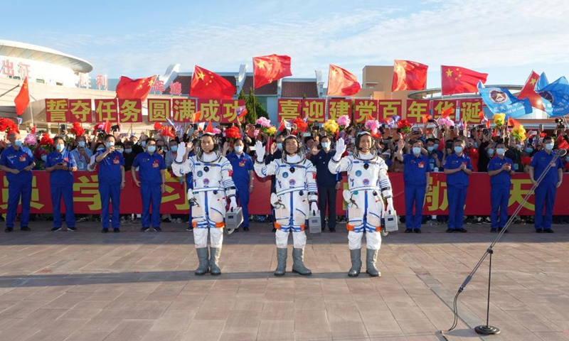Astronauts Nie Haisheng (R), Liu Boming (C) and Tang Hongbo wave during a see-off ceremony for Chinese astronauts of the Shenzhou-12 manned space mission at the Jiuquan Satellite Launch Center in northwest China, June 17, 2021. (Xinhua/Li Gang)