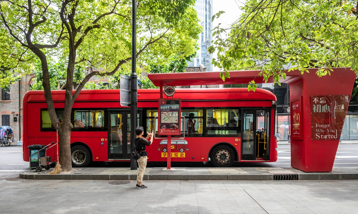 A red bus in Shanghai featuring the elements of the history of the Communist Party of China (CPC) would tour the