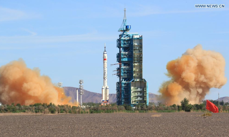 The crewed spacecraft Shenzhou-12, atop a Long March-2F carrier rocket, is launched from the Jiuquan Satellite Launch Center in northwest China's Gobi Desert, June 17, 2021. (Xinhua/Ju Zhenhua)