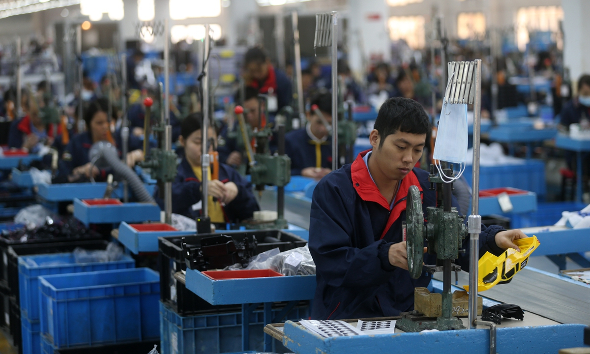 Employees of Masito work on production line in the company? workshop in Dongguan, South China's Guangdong Province on December 16. Photos: Cui Meng/GT