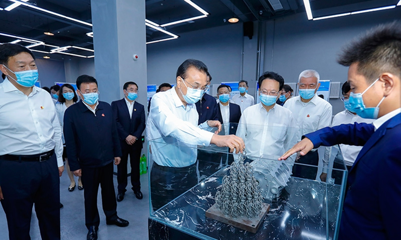 Premier Li Keqiang inspects a demonstration zone for international cooperation between China and the Republic of Korea (ROK) in Changchun, capital city of Northeast China's Jilin Province on June 16, 2021. Photo: gov.cn