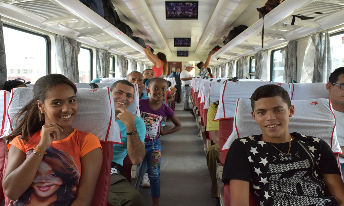 Passengers sit on-board a Chinese-designed and manufactured train in Havanaon July 13, 2019. It was the first time since 1975 that Cuba has purchased new railway coaches, which has provided an important underpinning for the modernization of Cuba's railway system in recent years.Photo: Xinhua