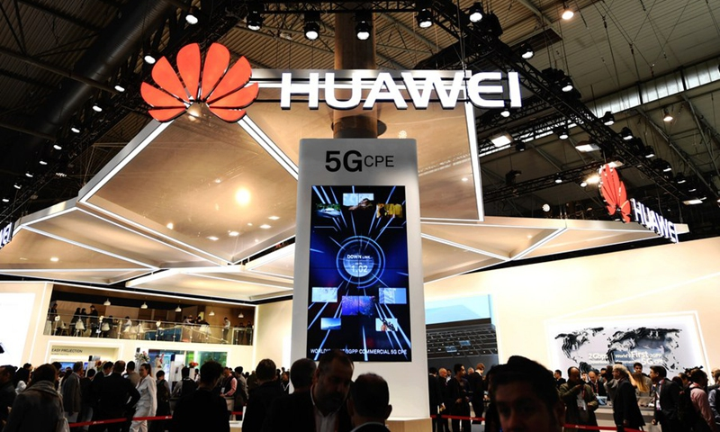 Photo taken on Feb. 26, 2018 shows a screen displaying the 5G technology at the booth of China's telecom giant Huawei during the 2018 Mobile World Congress (MWC) in Barcelona, Spain.(Photo: Xinhua)