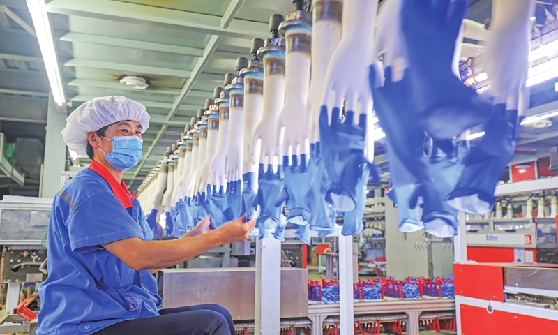 An employee works at a medical glove factory in Luannan county, North China's Hebei Province on Monday. The county, with an annual output of over 4 billion yuan ($619.13 million) worth of  medical gloves, has in recent years aimed to build itself into a manufacturing base for this product.  Photo: cnsphoto