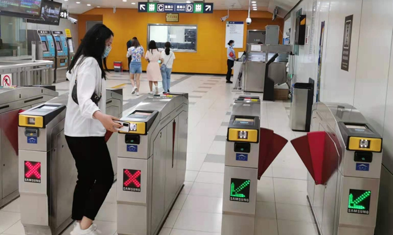 A passenger scans the code at a Beijing subway station on Wednesday. Photo: Yin Yeping/GT