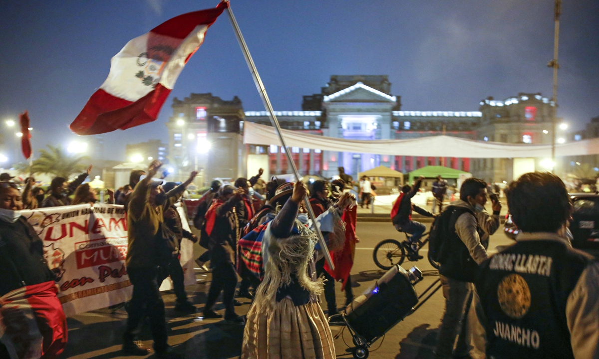 Supporters of leftist schoolteacher Pedro Castillo celebrate in downtown Lima following the official proclamation of him as Peru's president-elect on Monday. Photo: AFP