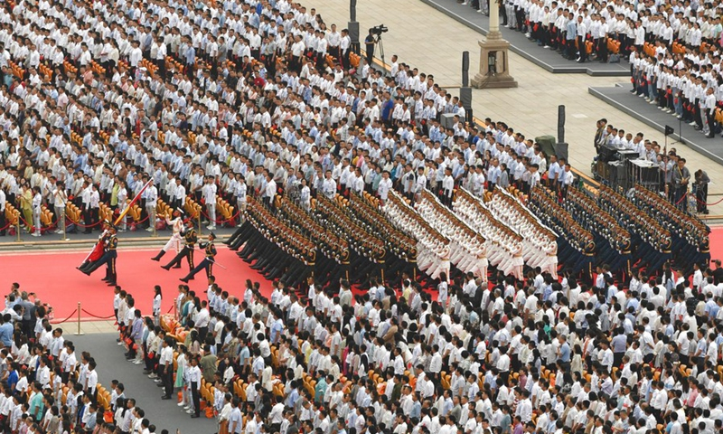 The national flag guards march during a flag-raising ceremony at a grand gathering celebrating the centenary of the Communist Party of China (CPC) at Tian'anmen Square in Beijing, capital of China, July 1, 2021.(Photo: Xinhua)