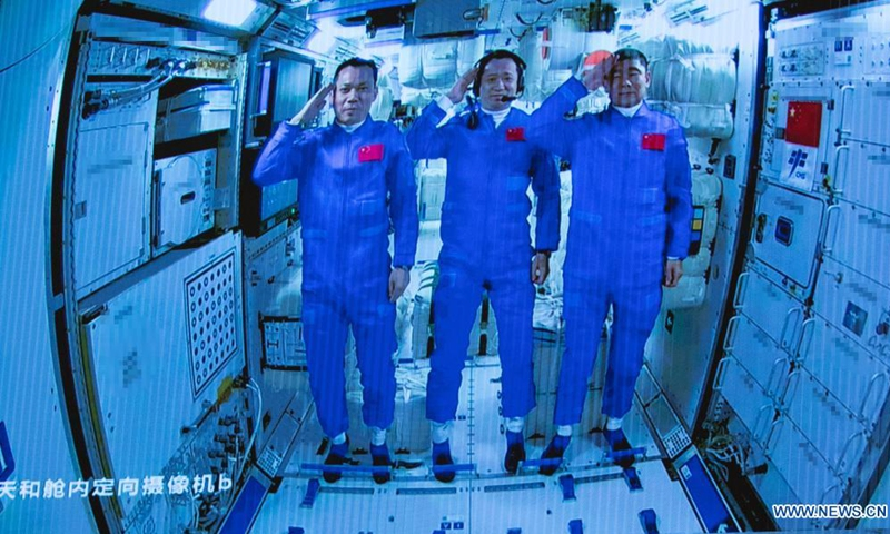 Screen image captured at Beijing Aerospace Control Center in Beijing, capital of China, June 17, 2021 shows three Chinese astronauts onboard the Shenzhou-12 spaceship saluting after entering the space station core module Tianhe. Photo: Xinhua