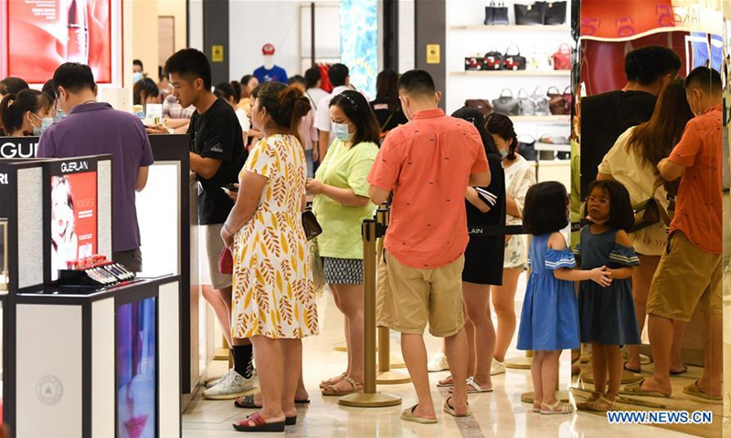Tourists shop at a duty-free makeup store in Haikou, capital of south China's Hainan Province. Photo: Xinhua