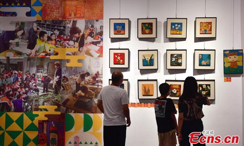 Residents see lacquerwares created by primary school students at an event in Fuzhou, Fujian Province on July 3, 2021. A total of 120 artworks were presented at the event. (Photo/ Zhang Bin)  Fujian Province is one of the birthplaces of Chinese modern lacquer painting. Well-known for its long history and sophisticated crafts, the bodiless lacquerware in Fuzhou was listed as one of China's national intangible heritages in 2006.