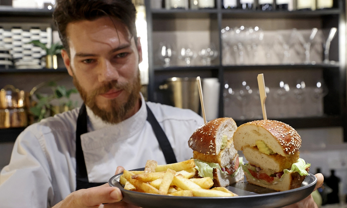 Israeli chef serves a burger made with
