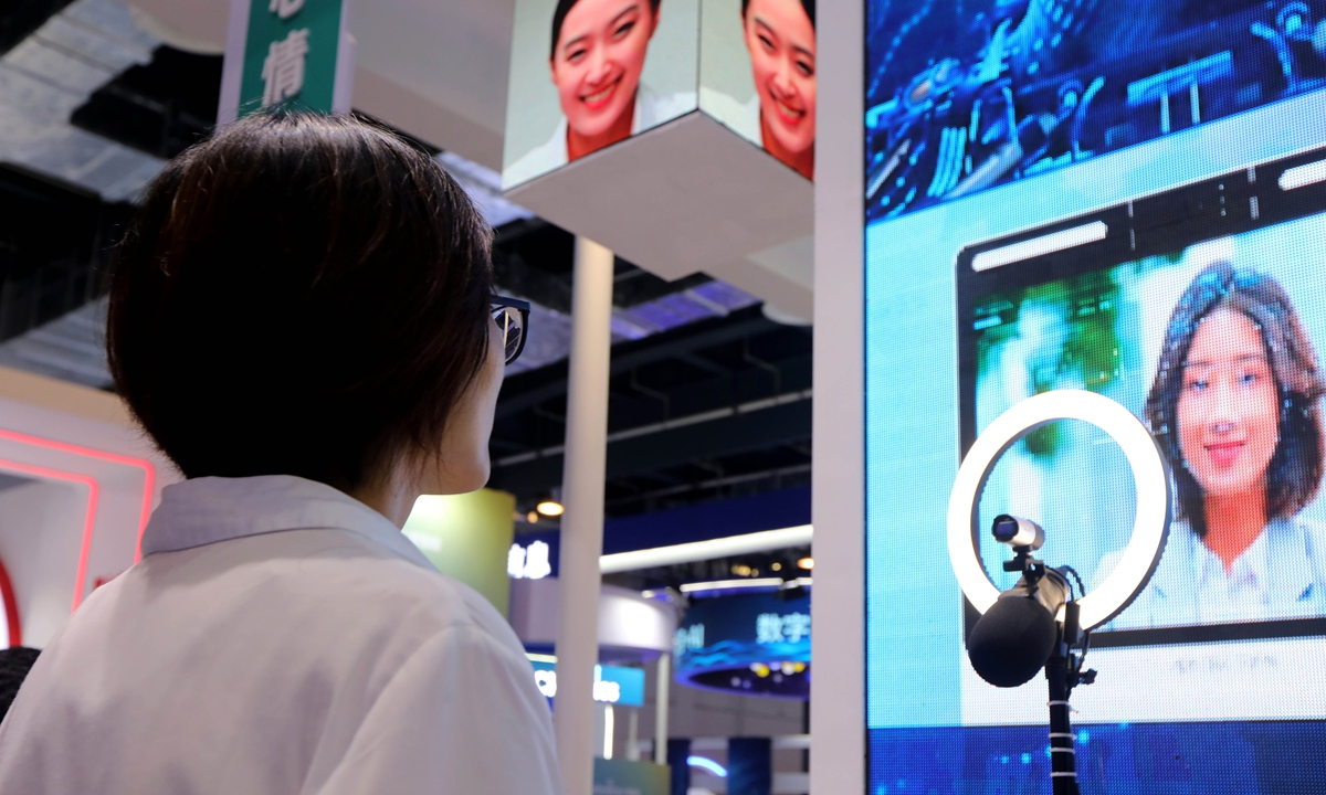 Vsitors experience artificial intelligence that detects and interprets human emotional signals at 2021 WAIC in Shanghai on Wednesday. Photo: Chen Xia/GT