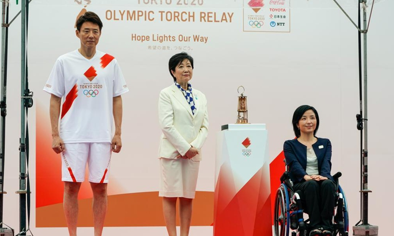 Governor of Tokyo Koike Yuriko (C), Official Ambassador of the Tokyo 2020 Torch Relay Taguchi Aki (R), and Japanese former professional tennis player Matsuoka Shuzo attend the unveiling ceremony for the Olympic Flame of the Olympic Torch Relay in Tokyo, Japan on July 9, 2021.Photo:Xinhua