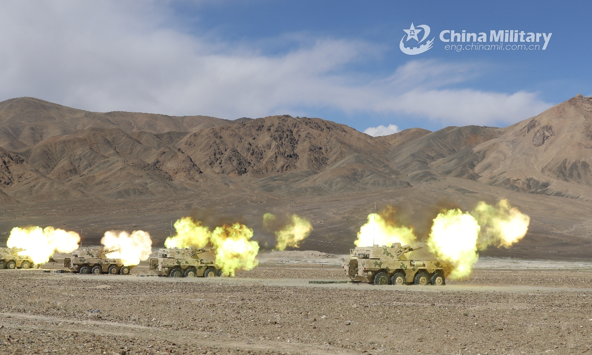 Vehicle-mounted howitzers attached to an artillery detachment with a combined arms regiment under the PLA Army fires high explosive shells at mock remote targets during a live-fire training exercise in depopulated region in mid-June, 2021. The exercise focused on such training items as autonomous surveillance, reduced-crew operation, motorized mobilization.Photo:China Military