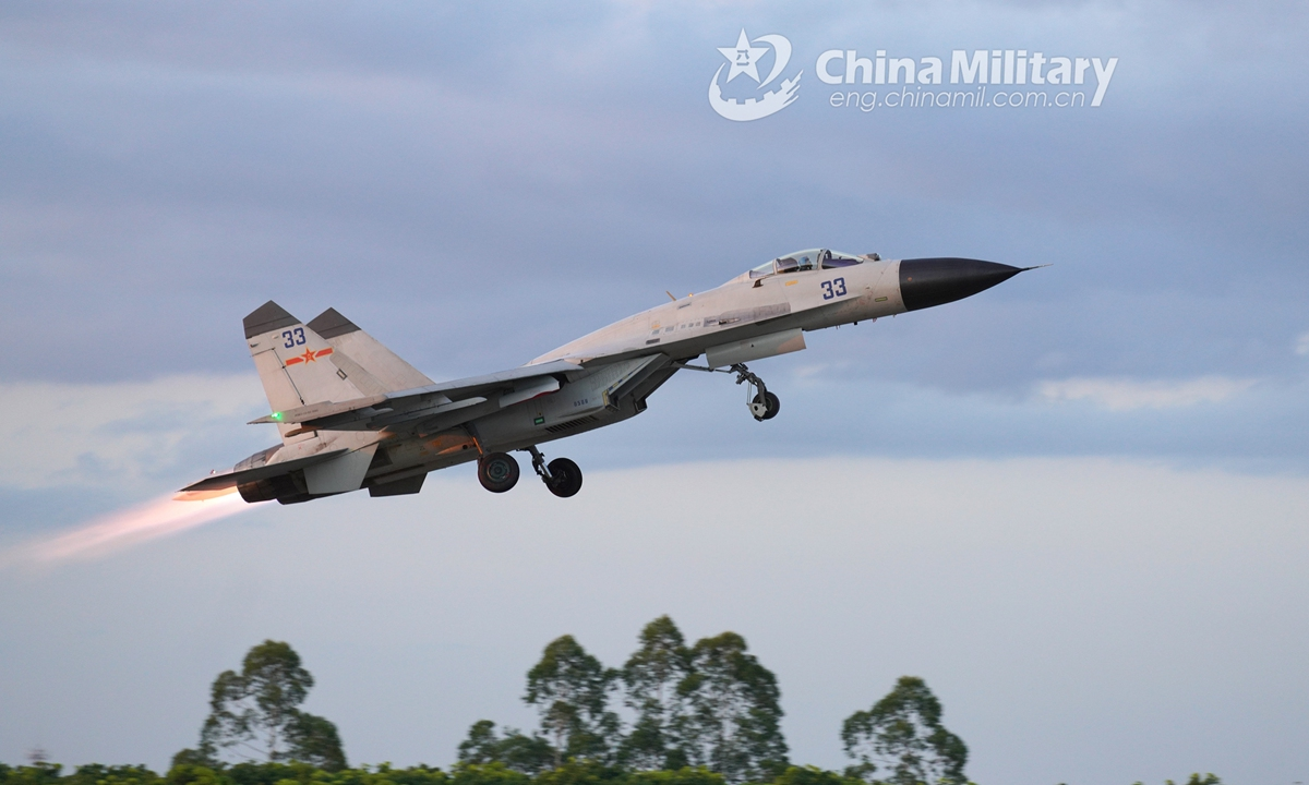 A fighter jet attached to an aviation brigade with the navy under the PLA Southern Theater Command takes off from the runway during a 24-hour flight training exercise. The round-the-clock training exercise focused on subjects including free aerial combat, seizing air-superiority operation, and assault covering operation.Photo:China Military