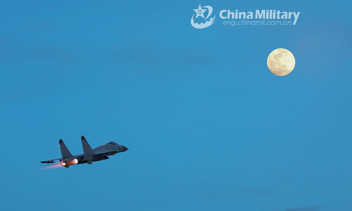 The double-exposed shot shows a fighter jet silhouetted against a full moon at night during a 24-hour flight training exercise organized by an aviation brigade with the navy under the PLA Southern Theater Command. The round-the-clock training exercise focused on subjects including free aerial combat, seizing air-superiority operation, and assault covering operation.Photo:China Military