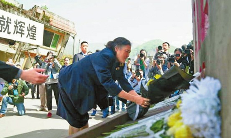 HRH Princess Sirindhorn visits the earthquake site in the old Beichuan County and lays flowers in 2018
