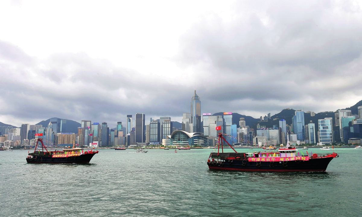 Fishing boats in Hong Kong are draped with celebratory flags and banners marking the 100th anniversary of the founding of the CCP and the 24th anniversary of Hong Kong's return to China.  Photo: IC