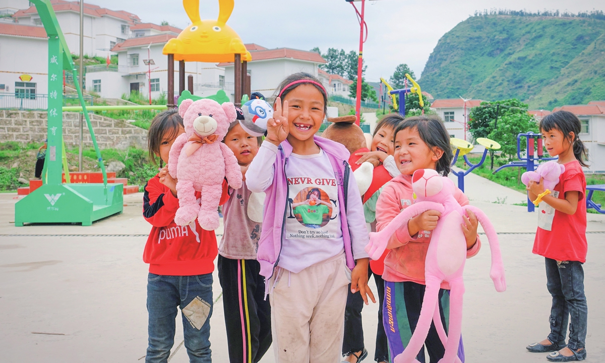 Female students take their school-issued toys to the playground  at recessin Huobo village in Puge county, Liangshan, on June 30. Photo: Lin Xiaoyi/GT