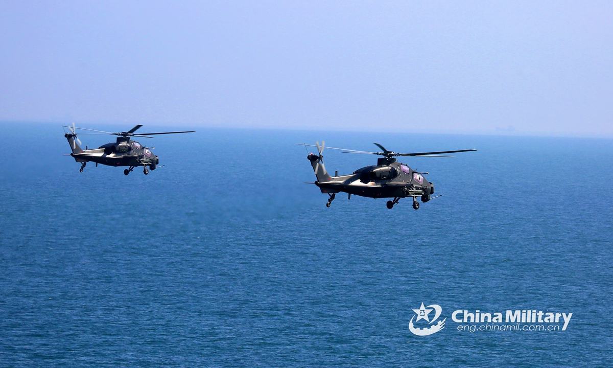 Two attack helicopters attached to an army aviation brigade under the PLA Eastern Theater Command fly in alongside formation above the sea at an ultra-low altitude during a flight training exercise on June 9, 2021. The flight training covered the subjects of two-plane formation flight, island defense penetration at low-altitude, maritime assault, etc.Photo:China Military