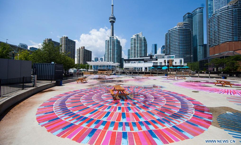 A floor mural with spirals, loops and circles is seen during a visual arts exhibition at Hahourfront Center in Toronto, Canada, on July 14, 2021.Photo:Xinhua