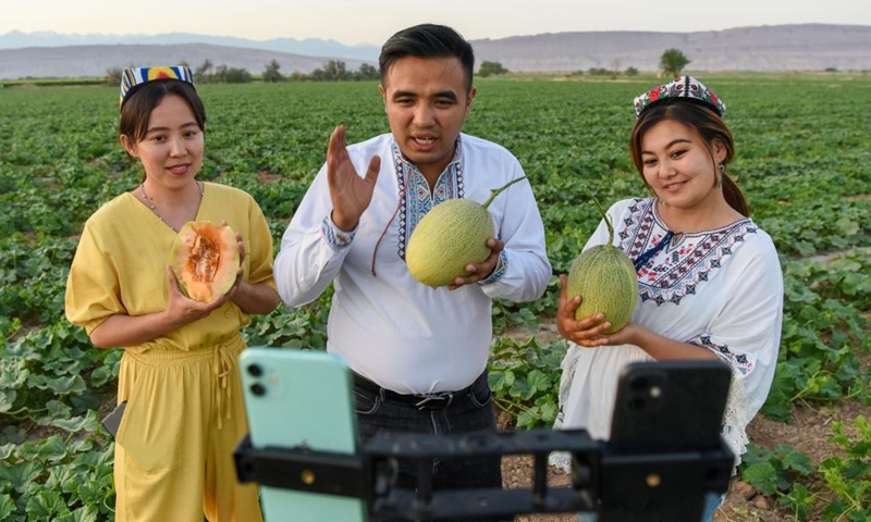 People promote Hami melons via livestreaming in Turpan of northwest China's Xinjiang Uygur Autonomous Region, May 19, 2021.Photo:Xinhua