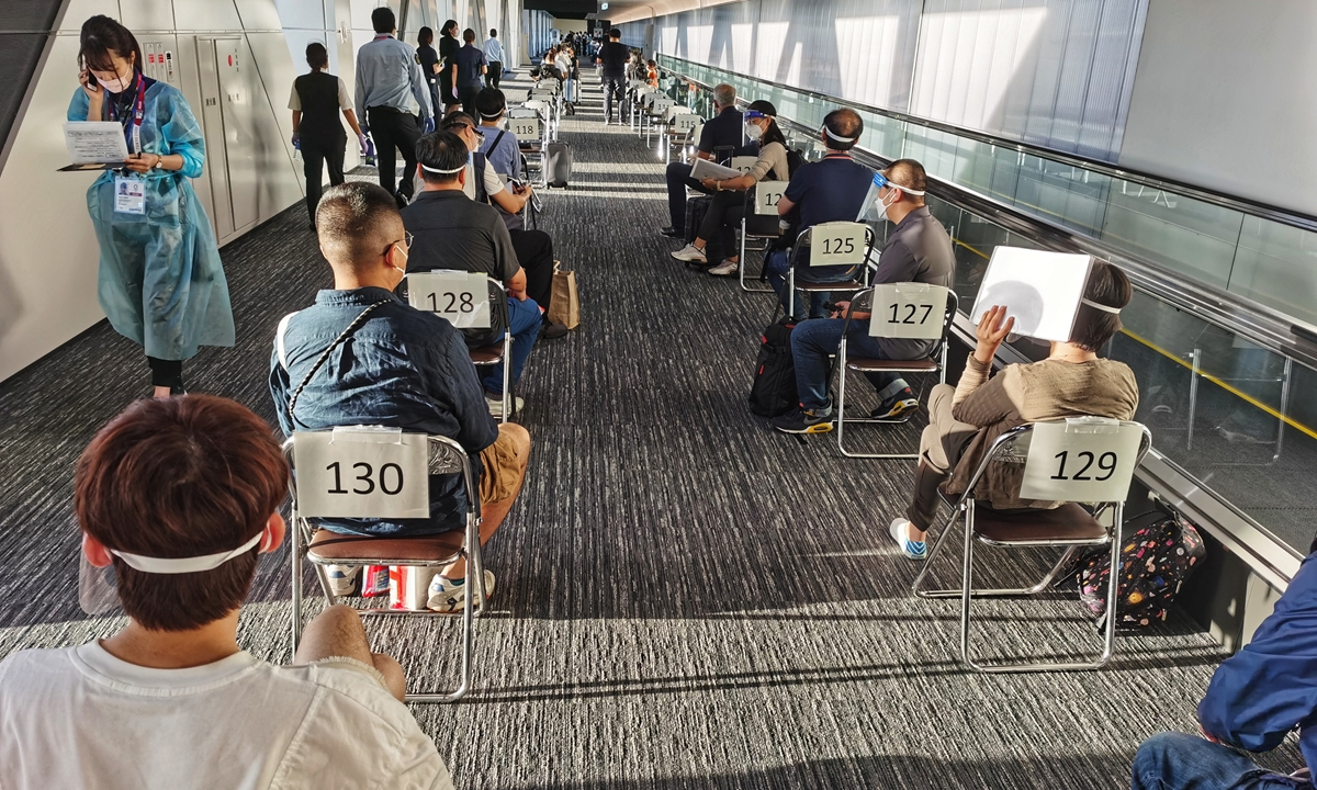 Olympics-related personnel wait for epidemic prevention and immigration checks after arriving at Narita International Airport on Sunday, five days before the opening of the Tokyo Olympic Games. Photo: Cui Meng/GT